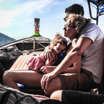 A sleepy family feeling the long seaward journey.